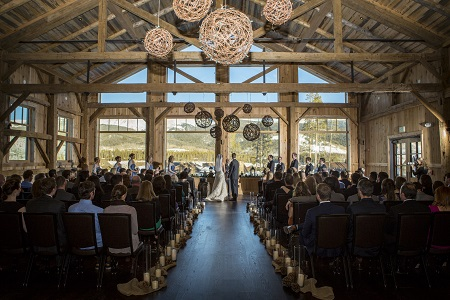 Wedding ceremony in High Lonesome Barn at Devil's Thumb Ranch, David Lynn Photography