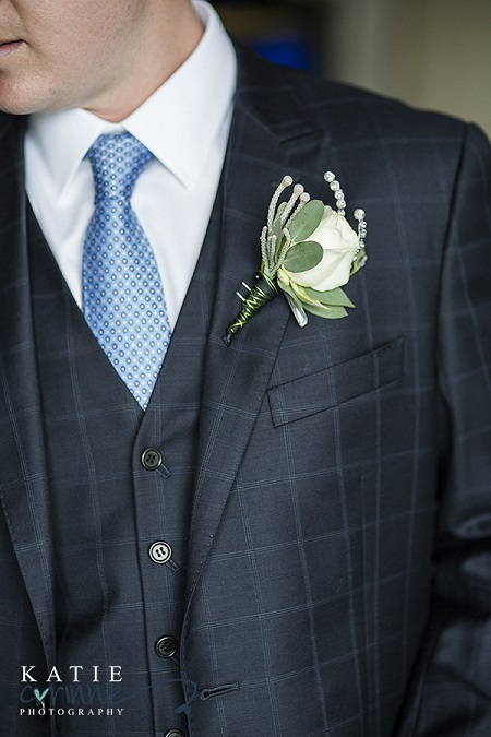 White rose boutonniere by Business Blooms