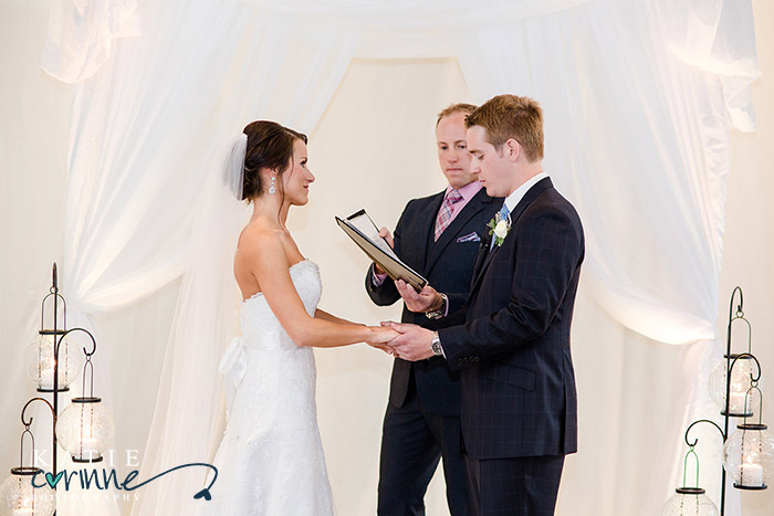 Exchanging vows in front of white drape, softens the look