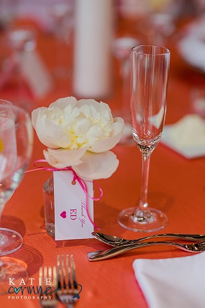 Wine carafe favors double as vase and place card