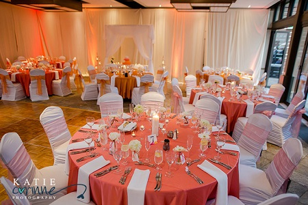 Sunset inspired linens with white chair covers & napkins