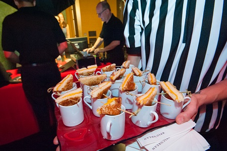 Soup & sandwich shooters served by a referee at basketball bar mitzvah, Jared Wilson Photography
